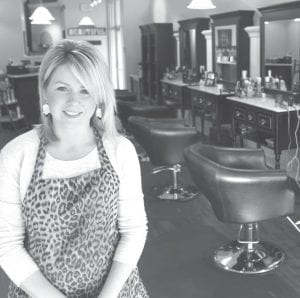 Samantha Lauber in the new location of Salon Bliss– the site of the former Carol Ann's City Café in historic downtown Archbold. Lauber said since she was a little girl, she wanted to be a hair stylist. She has had her own salon since 2000.– photo by David Pugh