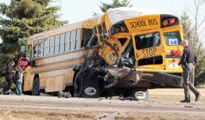 The aftermath of the collision between an Archbold school bus and a semi that occurred Wednesday, March 27, on US 6. Top and at right: The wreckage shows the bus was hit on the left rear corner. Bottom: The semi truck cab was torn off the frame by the impact.– photos by David Pugh