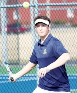 Andrew Hogrefe keeps his eye on the ball to return serve. He defeated opponents from Maumee Valley Country Day and Bluffton last week.– photo by Mary Huber