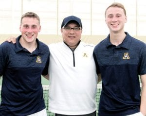 Erik Short, left, and Clay Gerig, flank James Kidder, AHS head boys tennis coach. Short and Gerig finished second at the Division II sectional tournament and open district tournament play tomorrow, Thursday, at BGSU.– photo courtesy Sarah Short