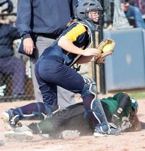 Archbold catcher Chloe Schramm tags out Evergreen's Andrea Smithmyer at home plate in the fifth inning of their Div. III sectional final.– photo by Mary Huber