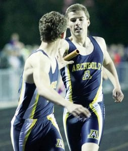 Trey Theobald takes the baton from Austin Roth in the boys 4x400 relay at the NWOAL meet. The Streaks finished second in the event.– photo by Mary Huber