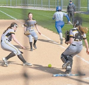 Pettisville pitcher Mackenzie Morgan, first baseman Kenzie Rivera, and catcher Mya Meck field a sacrifice bunt earlier this season.– photo by Mario Gomez