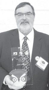 John Poulson with the Golden Owl award, recognizing him as Ohio Ag Educator of the Year.– courtesy photo