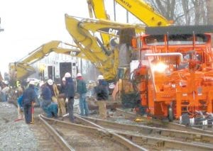 This photo was taken during the cleanup of a Nov. 23, 2010, Norfolk Southern train derailment in Wauseon. Like the Thursday night, June 6 incident in Swanton, the train was carrying cars loaded with shipping containers. Also like the Swanton incident, some of the derailed cars came to rest near homes.– photo by David Pugh