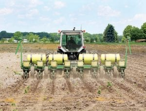 Terry Aeschliman, rural Archbold, was planting a field southeast of Pettisville on Co. Rd. 17, yesterday afternoon, Tuesday.– photo by David Pugh