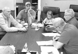 """Sophie Aeschliman, 5, sat in on the Monday, June 10 meeting of the German Township Trustees. With her are, from left, Andy Brodbeck, trustee; Jeff Aeschliman, road maintenance worker and Sophie's father; Keith Short, township fiscal officer; and Joe Short, president of the trustees. Not pictured: Kenneth """"Skip"""" Leupp, trustee.– photo by David Pugh"""