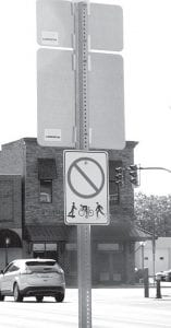 """""""No bike riding"""" on sidewalk sign in Archbold."""