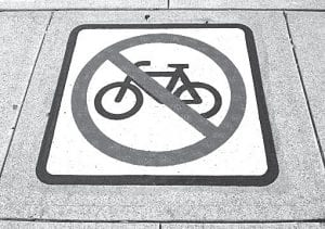 """Larger """"No bike riding"""" signs in downtown Bowling Green. Sign is painted on the sidewalk."""