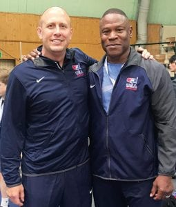 Brian Becher, left, with Kevin Jackson, a 1992 Olympic gold medalist and developmental coach for USA Wrestling. Becher thought he would be Jackson's assistant at the Under-15 World Freestyle Championships in Budapest, Hungary, but the two assumed equal roles, Becher said.– photo courtesy Brian Becher