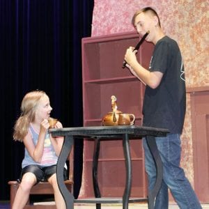 """Molly Rutledge, 10, West Unity, and Mason Stickley, Pettisville, rehearse a scene from the Archbold Community Theatre production of """"The Lion, The Witch, and the Wardrobe."""" The show will be performed on the stage in the Archbold High School auditorium Thursday, July 11, through Sunday, July 14.– courtesy photo"""