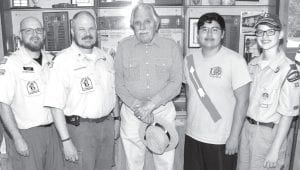 Above: These Archbold Boy Scouts participated in the first part of a 50-mile hike to commemorate a hike conducted 75 years ago by other boy scouts. From left: Chad Baus, assistant scoutmaster; Paul Reichert, scoutmaster; Ross Wm. Taylor, who was a member of Troop 63 and was on the original hike; and scouts Josiah Ruiz and Isaac Reichert. Missing from photo: Cam Short. Below: A juvenile bald eagle the group encountered on the hike.– top photo by David Pugh; below, courtesy photo