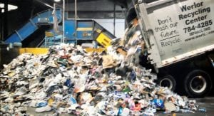 An ARS truck dumps materials collected from curbside recycling onto the floor of the MRF, or Material Recovery Facility. At the MRF, items that can be recycled are partially handsorted. Much of the material collected from residences can't actually be recycled.– courtesy photo