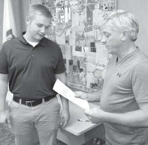 Grant Schaffner, Fayette, left, takes the oath of office as a new member of the Archbold Police Department with Jeff Fryman, mayor.– photo by David Pugh