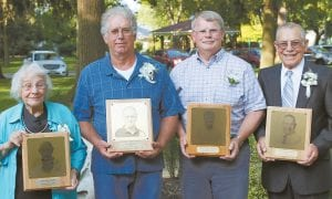 """Inductees of the 2019 Fulton County Agricultural Hall of Fame are, from left: the late William """"Bill"""" Hoops, represented by his widow, Marjorie; Lee Leininger, Emerson Nafziger, and William Schmitz.– photo by Mary Huber"""