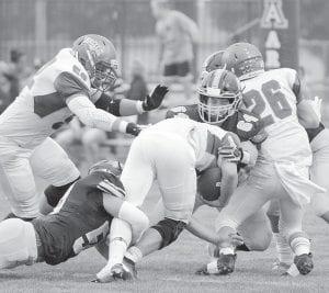 Archbold's Carson Meyer (50) and Mason Babcock (64) team up to tackle Liberty-Benton quarterback Michael Erdeljac.– photo by Mario Gomez