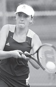 Maggie Henry concentrates as she returns serve.– photo by Mary Huber