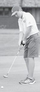 Malachi Schumacher putts the ball in AHS golf action earlier this season.– photo by Mario Gomez
