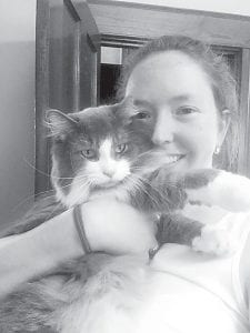Sonya Huser and GusGus, the cat that attempted to move into the Archbold Community Library last year, where Huser is director. When GusGus refused to move on, Huser took him home to live with her and her other cats.– courtesy photo