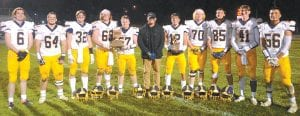 AHS senior football players hold the Northwest Ohio Athletic League and Lions Club trophies. The Streaks share the NWOAL title with Liberty Center, and won the Lions Club trophy for the third straight year. From left: Devin Witte, Mason Babcock, Elijah Zimmerman, Matthew Gladieux, Shane Eicher, Isaiah Gomez, Tony Grime, Zoey Tuckerman, Brayden Hall, Spencer Short, and Adrian Juarez.– photo by Mario Gomez