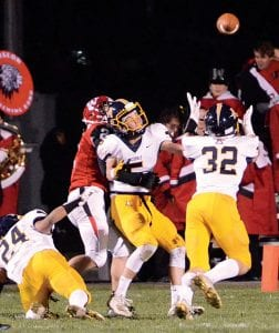 After Brandon Taylor (5) tips the ball away from Wauseon's Sean Brock (24), Elijah Zimmerman (32) was there for his third interception of the season. Helping on the play is Archbold's Noah Gomez (24).– photo by Mario Gomez