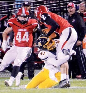 Spencer Short (41) gets an open field tackle of Wauseon's Connar Penrod. Short was the only Blue Streak in between Penrod and the end zone.– photo by Mario Gomez