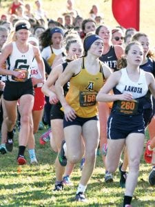 Kylie Sauder (bib 156) stays toward the front of the pack in the Division III girls race at the state cross country championships, Saturday, Nov. 2, in Hebron. Sauder finished 12th.– photo by Lynn Roth