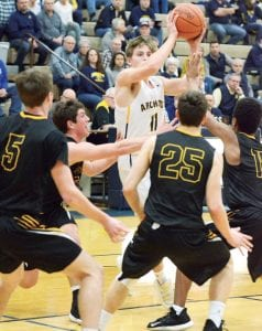 Elijah Zimmerman (11) draws the attention of a quartet of Apaches as he penetrates inside.– photo by Mario Gomez