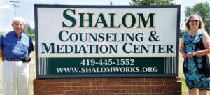 Ed Yoder and Becky Rupp are veteran members of the Shalom Counseling and Mediation Center Board of Directors. The two discuss their motivation to serve, and talk about the growth of the organization.– photo by Pam Graber