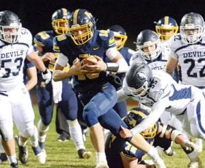 Quarterback DJ Newman, who rushed for 117 yards on 15 carries, speeds past the Carey defense, Saturday, Oct. 24.– photo by Mario Gomez