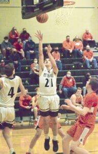 Pettisville's Jaret Beck (21) gets free under the basket and scores two of his 10 points in the Birds' Division IV sectional semifinal with Hicksville, Wednesday, Feb. 24.– photo by Mario Gomez