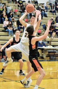 Archbold junior Tyler Hurst (23) goes hard to the basket and is fouled by a Liberty Center player during their Division III sectional final, Saturday, Feb. 27, in the Thunderdome. The Streaks survived a last-second shot attempt to win 36-34.– photo by Mario Gomez