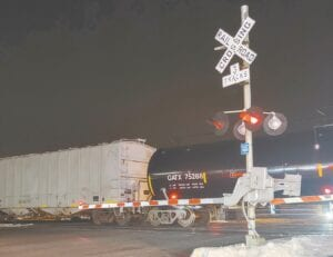 A train stopped at the Defiance Street Norfolk Southern crossing, Monday night, Feb. 22, blocked traffic for about an hour, from about 8:15-9:10 pm. Norfolk Southern railroad officials have promised to reduce the number of times trains stop and block the railroad crossings, and eliminate the incidents in which trains block the crossings for hours.– photo by David Pugh
