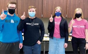 """These Pettisville High School students are the starters for the PHS Quiz Team, the """"Nerd Herd,"""" photographed after they won the 2020 Northwest Ohio Educational Service Center Invitational Tournament. From left, Levi Myers, a senior; Heath Waidelich, senior; Lyla Heising, junior; and Elise Hoylman, sophomore. The Nerd Herd won the varsity, junior varsity, and junior high divisions at the November competition.– courtesy photo"""