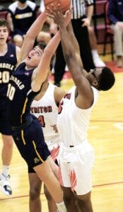 Archbold's DJ Newman (10) and Cardinal Stritch's Dwayne Morehead (5) reach for a rebound in their Division III district final.– photo by Mary Huber