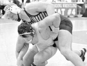 Meyer, top, works to turn Kirtland's Brennon Braud in the first round. Meyer opened his tournament with an easy 17-1 technical fall victory.