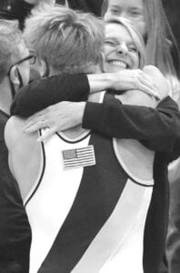 The celebration begins as Carson gives his mom, Crystal, a big hug after the championship match.