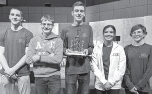 These high school-age students from Archbold Evangelical Church won a Bible quiz meet, Saturday, March 6, in Illinois. With their trophy are, from left: Stephen Diller, Marek Kreiner, Kaiden Keiser, Zoe Arend, and Kyra Kreinerk.– courtesy photo