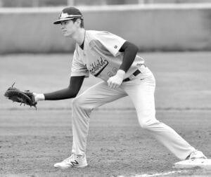 Ashton Kammeyer fields the ball at first base.