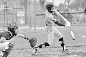 Gavin Bailey makes contact with the ball at the plate.