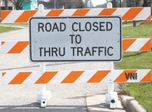 """""""Road Closed"""" signs went up yesterday morning, Tuesday, on East Holland Street east of Vine Street. Digging on the road project is expected to start today, Wednesday.– photo by Mary Huber"""