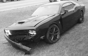 This Dodge Challenger, which crashed during a high speed chase through Archbold Jan. 11, is impounded at AA Truck Service, rural Archbold. Originally, it was said to have been released to the Strongsville dealership from which it was reported stolen. In fact it has been impounded at the AA Truck Service lot since the day of the chase. It is being held as evidence. This photo was taken the day of the chase.– photo by David Pugh