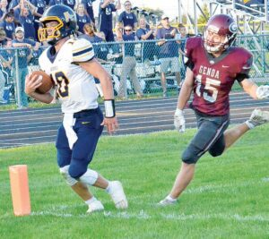 Quarterback DJ Newman (10) scored on a 64-yard touchdown and had one touchdown called back because of a penalty in Archbold's season opener at Genoa, Friday, Aug. 20. The Streaks shut out the Comets 27-0.– photo by Mario Gomez