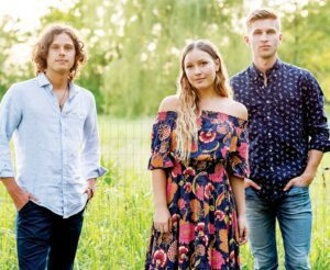 """From left, siblings Josh, Bekah, and Caleb Liechty, who are, together, the musical group, """"Girl Named Tom."""" All three are Pettisville High School graduates. Josh and Caleb have bachelor's degrees from Goshen (Ind.) College. The three have a chance for national exposure, having auditioned for the music competition television show """"The Voice.""""– photo courtesy Ambria Photography"""