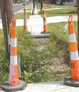 A small section of sidewalk on the south side of East Holland Street remains unfinished.– photo by Mary Huber